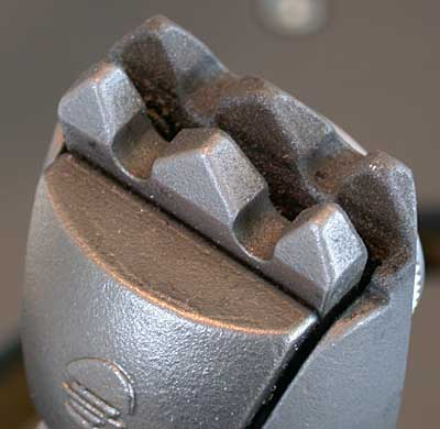 Titanium-oxide-dusted clamp